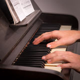 Playing on a piano Stock Photography