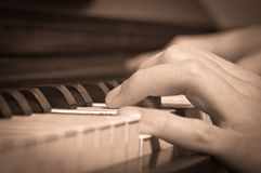 Playing on a piano Stock Photo