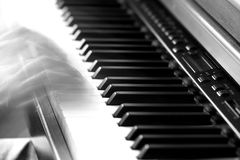 Playing piano A Stock Images