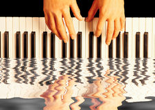 Playing piano reflection. Water reflection to show the beauty of playing piano Royalty Free Stock Images