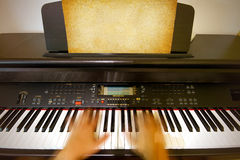 Playing piano Stock Images