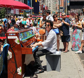 Playing the piano in times square. Pianist playing the piano in times Royalty Free Stock Photos