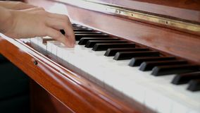 Playing piano. With two hands stock footage