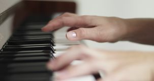 Playing piano. Two hands playing a gentle piece on a beautiful grand piano. 4K footage stock video footage