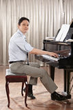 Playing piano Stock Image