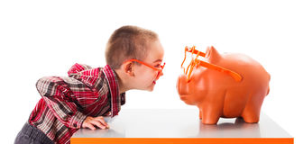 Playing with Piggy Bank Royalty Free Stock Photography