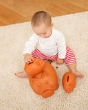 Playing with piggy banks Stock Photography