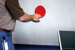 Playing ping pong. Office man playing ping pong at break time Stock Images