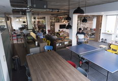 Playing ping pong tennis at creative office space Royalty Free Stock Image