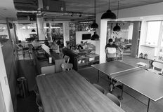 Playing ping pong tennis at creative office space Royalty Free Stock Photo