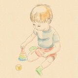 Playing_piramid_boy Stock Image