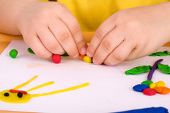 Playing with plasticine Stock Images
