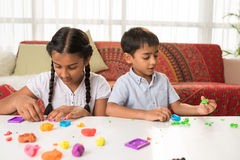 Playing with playdough royalty free stock photo