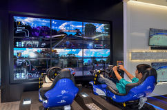 Playing Playstation 4 in Sony Center, Dubai Mall, Dubai. Sony Center Dubai Mall, United Arab Emirates stock images