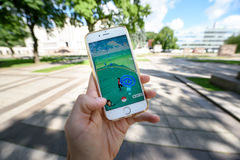 Playing Pokemon Go game Stock Images