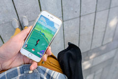 Playing Pokemon Go game Royalty Free Stock Photography