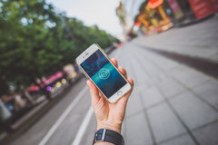 Playing Pokemon Go game. KAUNAS, LITHUANIA - JULY 24, 2016: Person holding mobile phone and playing Pokemon Go game. Pokemon Go is a location-based augmented Royalty Free Stock Photos