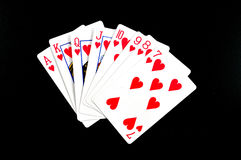 Playing poker. With street of hearts Stock Images