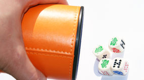 Playing poker. Vintage poker dice and box over white felt Royalty Free Stock Photo