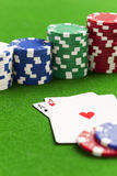 Playing poker. In the casino with winning hand royalty free stock photo