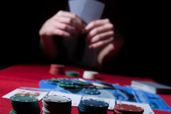 Playing poker. With a beautiful lady stock photography