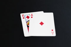 Playing poker cards ace king on black background Royalty Free Stock Photography