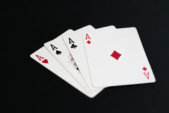 Playing poker cards aces on black background Royalty Free Stock Photography