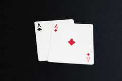 Playing poker cards aces on black background Royalty Free Stock Photo