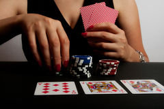 Playing Poker in Casino Stock Photography