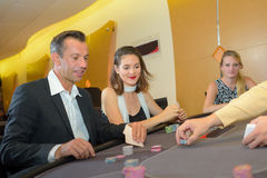Playing poker in casino Stock Images