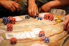 Playing poker with friends Royalty Free Stock Images