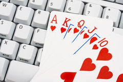 Playing poker online Royalty Free Stock Photography
