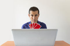 Playing poker online royalty free stock photo