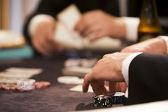 Playing poker at table gamblin. G with chips and cards 2 people Stock Photos