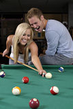 Playing Pool. A couple playing pool Stock Images