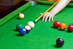 Playing pool. On green table Royalty Free Stock Photo