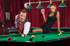 Playing pool. Royalty Free Stock Images