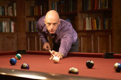 Playing pool billiards Stock Image