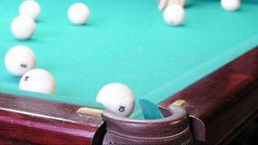 Playing pool, hitting the balls stock video footage