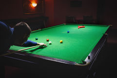 Playing pool, man aiming the billiard ball. Snooker Stock Photos