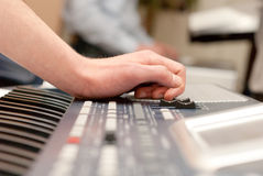PLAYING PROFI ELECTRONIC MUSIC KEYBOARD Stock Image