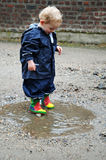 Playing in a puddle Royalty Free Stock Image