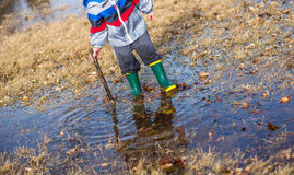 Playing in Puddles Royalty Free Stock Images
