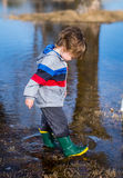 Playing in Puddles stock photography