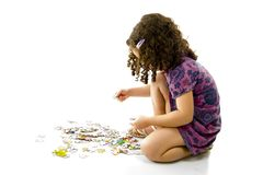 Playing with puzzle Royalty Free Stock Photos