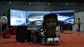 Playing a racing game on car simulation. Bangkok, Thailand - June 27, 2015 : Unidentified man playing a racing game on car simulation in car show event at stock video footage