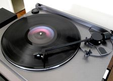 Playing a Record. Photo of record being played on a 1980's era record player bought just as digital cd's were being introduced. Some people still have records Royalty Free Stock Photos
