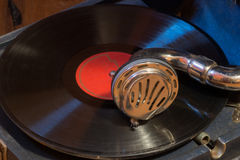 Playing record on an old phonograph. Playing a 78 rpm shellac record on an old gramophone Stock Photos