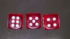 Playing red Casino Dice Cubes on a Glass Table. stock video footage