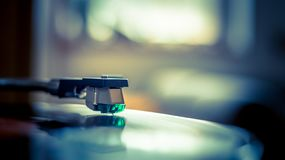 Playing retro music: Professional turn able audio vinyl record music player. Close up picture of a record player, playing a record vinyl music retro vintage royalty free stock image